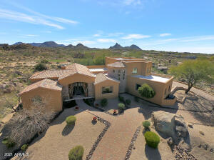 Perched on a natural rise, surrounded by dramatic panoramic views.