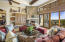 Great room with stunning soaring stone and marble fireplace