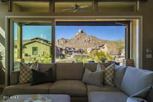 UVA tinted windows and wall-to-wall upgraded multi-slide door framing Pinnacle Peak Mountain!