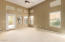 Spacious owners suite with access to backyard and covered patio.