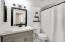 Master bathroom with a full shower and bathtub