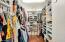 Large walk-in closet with organized shelving