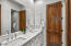 Ensuite bath to bedroom 2 with double sinks