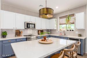Remodeled kitchen. Two tone cabinetry, quartz countertops and custom backsplash.