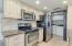 Kitchen: SS Appliances, tile backsplash.