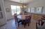 Spacious and bright with built in cabinetry and glass door leading to private patio.
