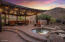 Family and friends will enjoy gathering under the outdoor ramada with bistro lights.