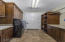 Laundry Room | Custom Built Shelves And Hanging Rods