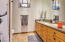 Full Bath, updated countertops, sink, faucets, planked decor wall