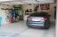 Side by side garage has water softener & bike rack