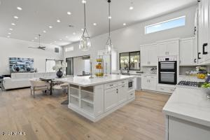 Large kitchen island with designer kitchen features. Many cabinets plus large panty.