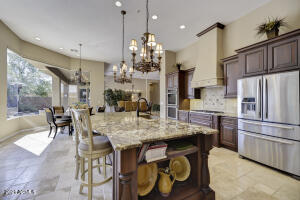 Massive island with beautiful granite countertops tying in all colors of the home