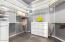 Master closet has custom modular storage system
