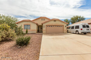 Beautiful single story home with plenty of driveway & RV gate!