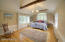 Master Bedroom with Vaulted Ceiling and wood floors