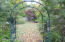 Arch leading to private rear yard