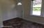 Enter into a multi space perfect for dining room or large foyer w/closet.