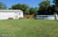 Spacious, Flat, Private, & Fenced Back Yard. Shed is attached to Garage