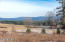 The view from the yard over farm fields to the mountains