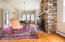 STONE FIREPLACE, SCONCES AND A CANDLE CHANDELIER
