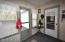 Door to back yard and garage, great mudroom or rainy day sitting area