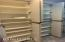 3 rows of floor to cieling custom kitchen shelving