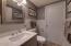 Updated half bath on lower level.