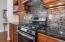 Gas range, custom tile & gorgeous granite counters