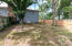 private fenced in area for pets or children. access also from garage