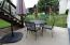 Lower patio looks out to the large back yard with a negotiable play set.