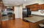 Updated in 2013 - countertops, sink, faucet, tile, backsplash, GFCI outlets, and some lighting.