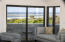 A view of the master bedroom's 159 SF private deck and the beach beyond.