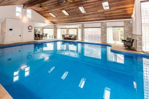 Large 15 X 20 salt water pool has been renovated. The Pool house is enclosed with windows. has a locked wine/beverage closet.