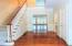 Stunning 3-Story entryway boasting attractive wood floors throughout main level.