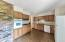 Kitchen features oak cabinets, and large walk in pantry!