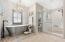 Free-standing raised tub and single slab quartz shower