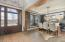 Large 2-story foyer features reclaimed wood trim leading to dining room