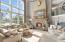 Floor-to-ceiling stone, stucco and reclaimed wood fireplace