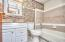 New granite countertop, new over mirror lighting, new wall-in medicine cabinet, shower/tub combo with marble tile backsplash, toilet commode button, wood trim, new mosaic tile backsplash, ivory painted walls