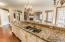 HUGE CENTER ISLAND, GRANITE COUNTER, AND KOEHLER FAUCET