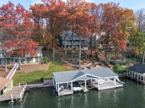 4 Bay boat dock, kitchen, bar, TV, slide, covered seating