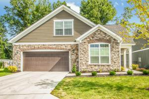 Stone and LP SmartSide siding exterior, concrete drive, keyless drive, coach lights, porch light, front covered porch, private fenced courtyard, lever locks, 2 panel doors, backs to wooded & protected area.