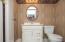 1st floor 1/2 bath w/ newer vanity/sink.