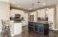 Plenty of seating in the kitchen -- breakfast bar and an island!
