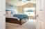 Master Bedroom with double doors and cathedral ceiling