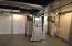The basement is where you'll find the new (2018) furnace and hot water tank. New glass block windows in the basement also.