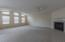 Huge Great Room with Gas Log Fireplace, Vaulted Ceiling, and a Wall of Windows