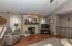• New hardwood flooring ~ 2015/2016 • Grey painted walls • Vaulted ceiling • Lighted ceiling fan • Brick fireplace with gas logs and mantle • Can lighting • Plant ledge