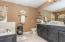 • Ceramic tile flooring • It tobacco painted walls • Enclosed vanity with double bowl, granite sinktop • 3 bulb wall light • Hanging light • Whirlpool® tub with ceramic tile surround • Shower stall with glass door • Wall mirror remains
