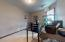 """• Light sand carpet • Tan painted walls • Ceiling light • 2"""" blinds • French doors"""